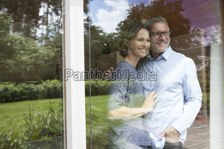 smiling mature couple looking out of