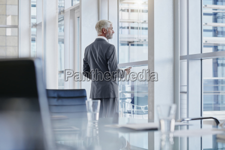 businessman looking out of the window