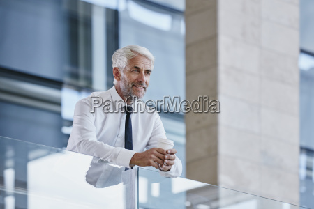 businessman relaxing with coffee