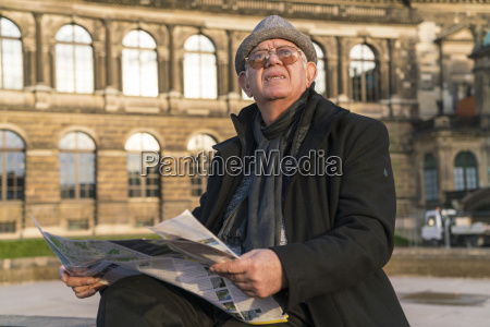 germany dresden senior man with newspaper