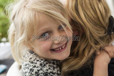 portrait of happy blond girl hugging