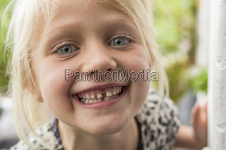 portrait of happy blond girl