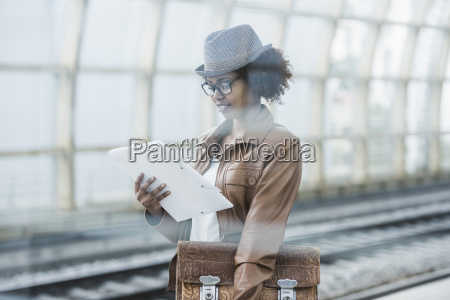 young woman with briefcase and file
