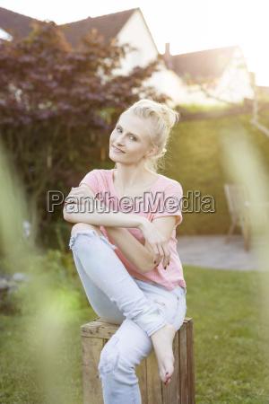 portrait of blond woman in garden