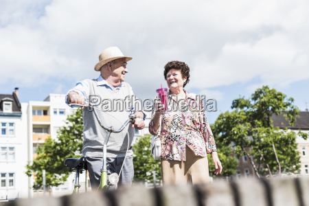 happy senior couple with bicycle and