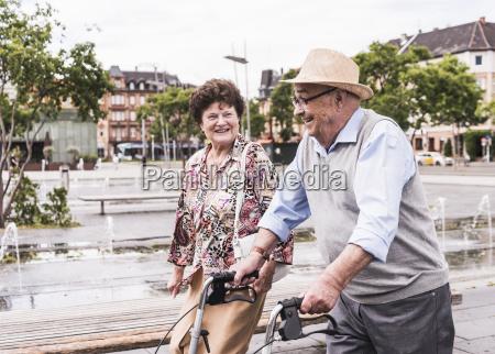 senior man using wheeled walker for