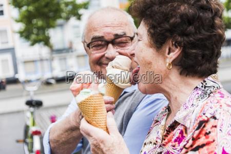senior couple enjoy eating ice cream