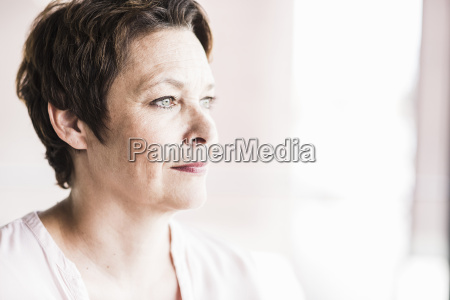 portrait of pensive businesswoman looking through