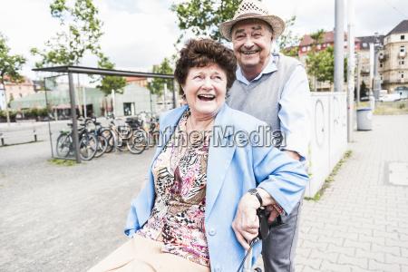 happy senior couple with wheeled walker