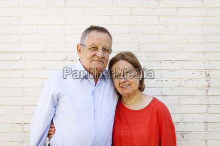 portrait of senior couple in front