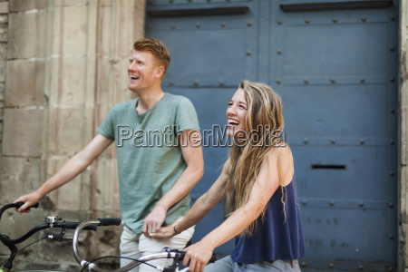 portrait of laughing woman with bicycle