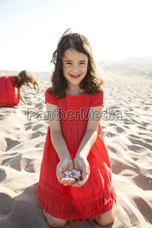 portrait of smiling little girl kneeling