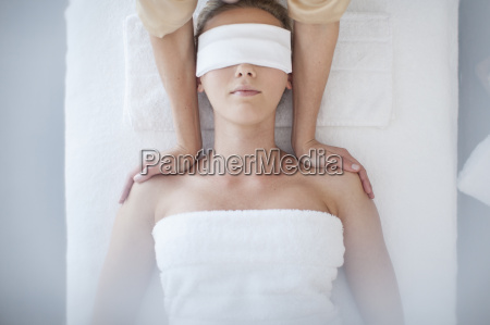 young woman lying on massage table