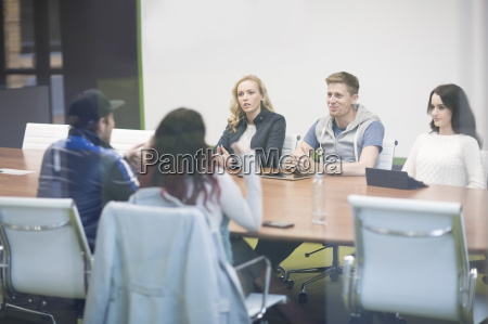young people discussing in business meeting