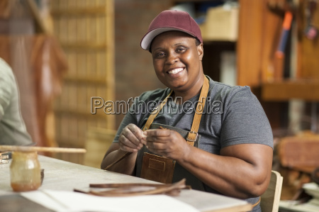 portrait of smiling woman in leather