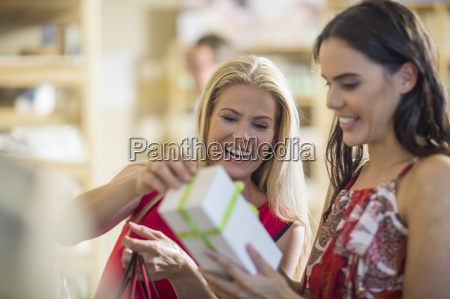 two happy women with gift box