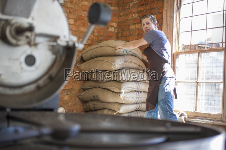coffee roaster with bag of beans