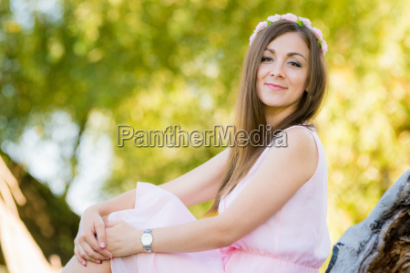 beautiful girl sits on a background