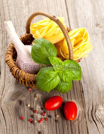 italian pasta with fresh basil leaves