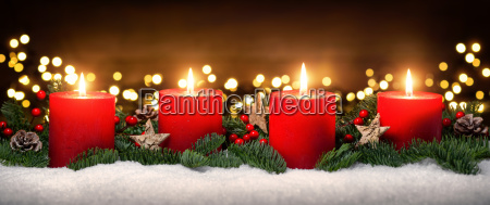 advent decoration with four candle flameslightssnowfir