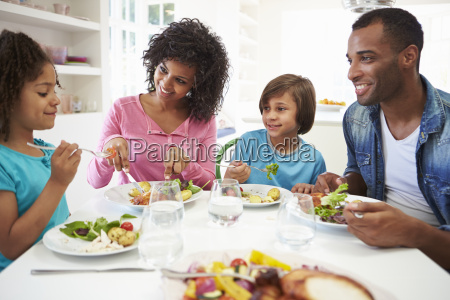 african american family eating meal at