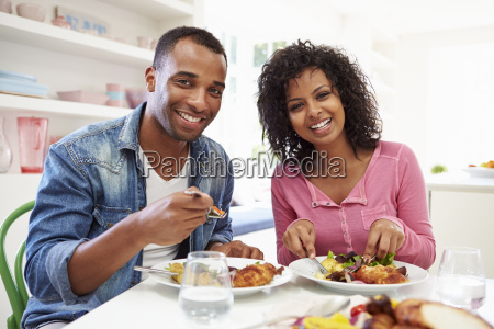 young african american couple eating meal