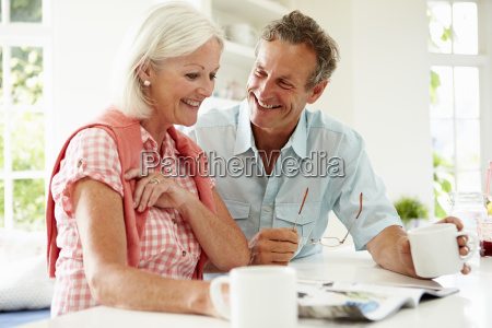 middle aged woman couple magazine over