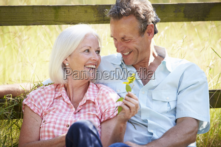 middle aged couple relaxing in countryside