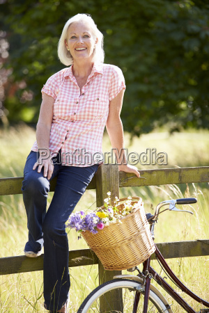 middle aged woman relaxing on country