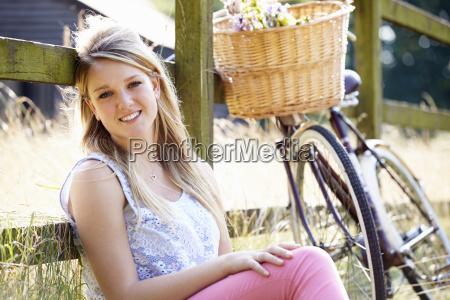 teenage girl relaxing on cycle ride