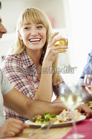 young woman relaxing at dinner party