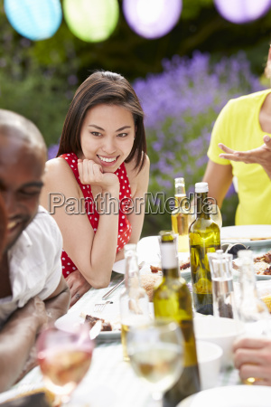 young woman relaxing at outdoor barbeque