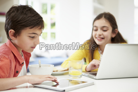 children with digital tablet and laptop