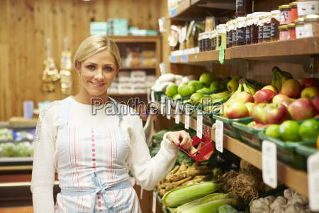 female sales assistant at vegetable counter