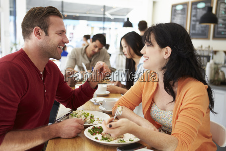 couple meeting for lunch in busy