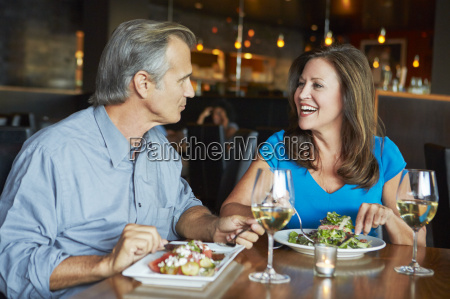 mature couple enjoying meal at outdoor
