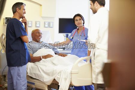 medical team meeting with senior man