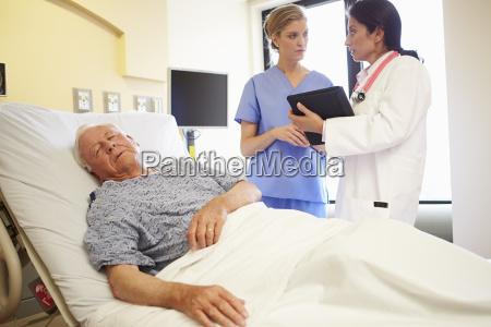 medical team meeting as senior man