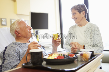 senior couple in hospital room as