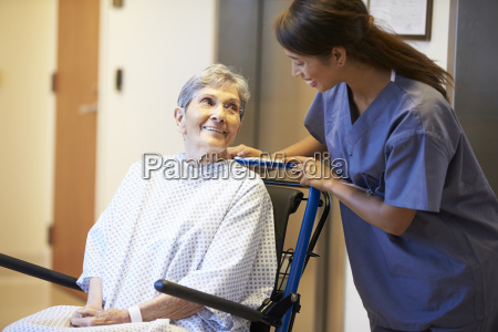 senior female patient being pushed in