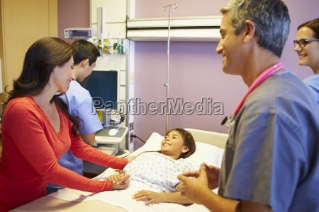 mother and daughter with medical staff