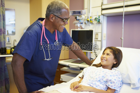 young girl talking to male nurse