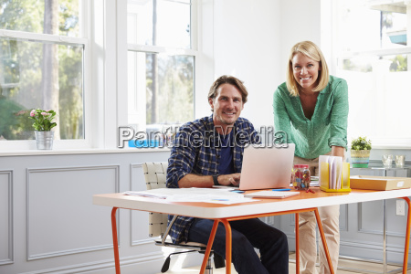 portrait of couple working together at