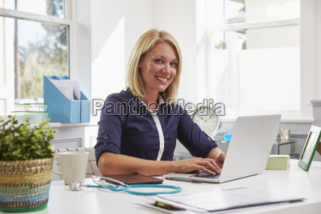 female doctor sitting at desk working