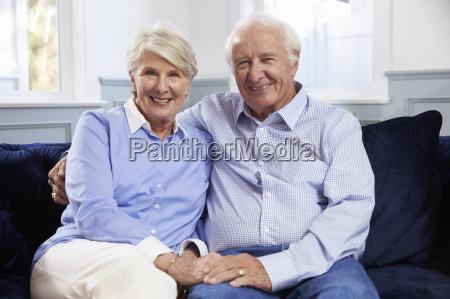 portrait of senior couple sitting on