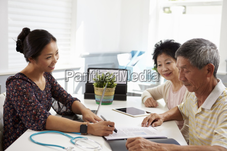 senior couple meeting with doctor in