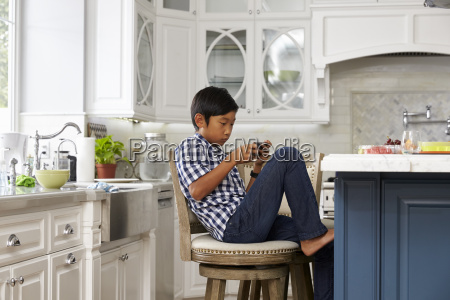 young asian boy playing game on