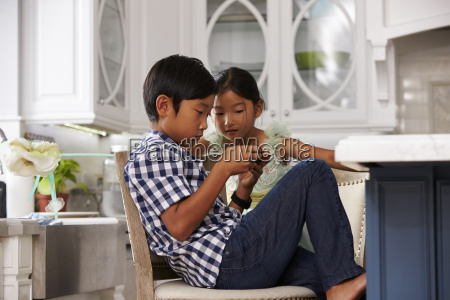 asian children playing games on mobile