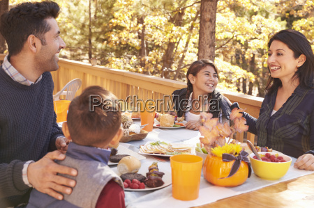happy family eating at table on