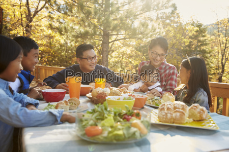 asian family having lunch outside at